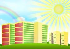 Himmel- und Regenbogenhintergrund mit Wohnblöcken Lizenzfreies Stockbild