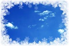 Himmel und Schneeflocken Stockbild