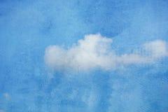 Himmelwolken auf Wandbeschaffenheitshintergrund Lizenzfreie Stockfotografie