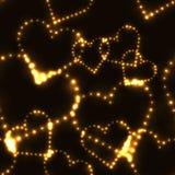 Hinaufkletternde Herzen des Neons Goldauf dunklem Hintergrund Lizenzfreie Stockfotografie