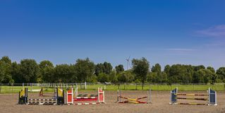 Obstacle course on a training field for riders stock image