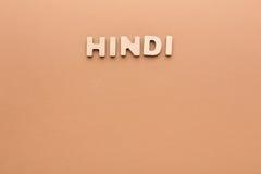 Hindi de Word sur le fond beige photographie stock