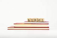 Hindi language word on wood stamps and books Stock Photography