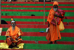 Hindi Monks at Varanasi. Hindu men in religious contemplation on the steps of the Hindu Ghats near the Holy River Ganges in Varanasi in northern India. The river Royalty Free Stock Photography