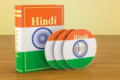 Hindibok med flaggan av Indien och CD disketter på trätabellen royaltyfri illustrationer
