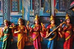 Hindische deva Carvings und Lack. Stockfotos