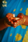 Hindu. A Hindu devotee holds an oil lamp royalty free stock photography