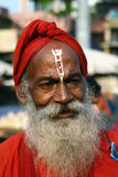 Hindu. The Hindu oldman in red clothes stock photo