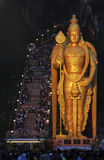Hindu. The gold colour giant statue of Hindu Lord Muruga at the Malaysia's 272-step Batu Caves temple in Kuala Lumpur, 2006 stock photo