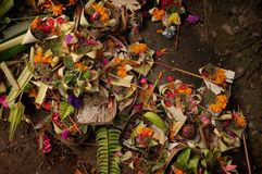 Hindu-Balinese offerings of flower petals, palm leaves, incense sticks and rice in Ubud, Bali, Indonesia Royalty Free Stock Photo