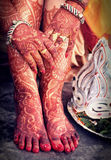Hindu Bridal background. Hindu Bridal hand and legs, painted with mehendi Royalty Free Stock Image