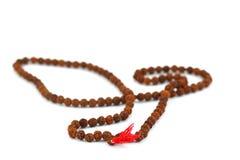 Hindu and buddhist prayer beads garland on white Stock Images
