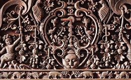Hindu carving. Sophisticated wooden carving on the hindu temple Stock Photo