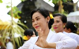 Hindu celebration at Bali Indonesia, religious ceremony with yellow and white colors, woman dancing. stock image