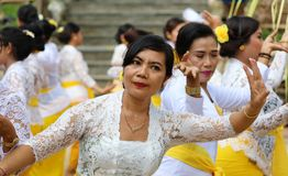 Hindu celebration at Bali Indonesia, religious ceremony with yellow and white colors, woman dancing. Culture dance stock photo