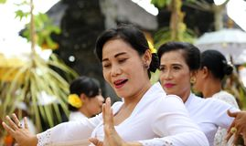 Hindu celebration at Bali Indonesia, religious ceremony with yellow and white colors, woman dancing. royalty free stock photography