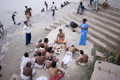 Hindu ceremony. This is a certain kind of hindu ceremony carried out beside the river Ganges. The youngman's parents were watching and recording this significant Royalty Free Stock Images