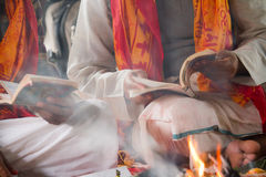Hindu ceremony in Nepal, Shivaratri. Hindu ceremony in Nepal, on the occasion of Shivaratri, two priests pray for God Shiva, read mantras in front of fire stock images
