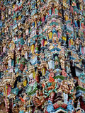 Hindu colorful Gods statues on a gopuram in India. Colored statue on the wall in front of the entrance to the hindu temple with ornament and decorations. Man and royalty free stock photos