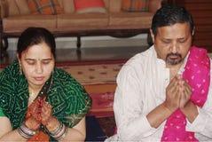 Hindu couple praying Stock Photo