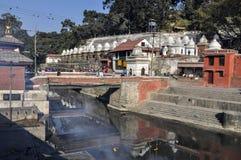 Hindu cremation rituals at the banks of Bagmati river Stock Photo