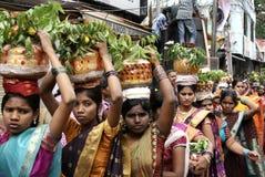 Hindu Devotee carrying Bonam during Bonalu fesival. Stock Images