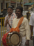 Hindu Devotee carrying a Drum Stock Images