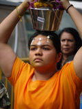 Hindu Devotee carrying a milk pot Stock Images