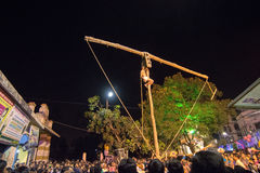Hindu devotee hanging from pole for Charhak festival, for welcoming Bengali new year 1424. Royalty Free Stock Photography