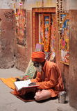 Hindu devotee reads and reciting sacred texts Royalty Free Stock Photography