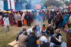 Hindu devotees , Babughat, Kolkata. BABUGHAT, KOLKATA, WEST BENGAL / INDIA - 9TH JANUARY 2013 : Hindu devotees lighting a camp fire on 9th January, 2013 at Stock Photo