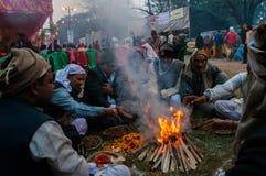 Hindu devotees , Babughat, Kolkata. BABUGHAT, KOLKATA, WEST BENGAL / INDIA - 9TH JANUARY 2013 : Hindu devotees lighting a camp fire on 9th January, 2013 in Stock Photo