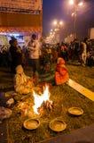 Hindu devotees , Babughat, Kolkata. BABUGHAT, KOLKATA, WEST BENGAL / INDIA - 9TH JANUARY 2013 : Hindu devotees lighting a camp fire on 9th January, 2013 in Stock Photos