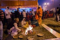 Hindu devotees , Babughat, Kolkata. BABUGHAT, KOLKATA, WEST BENGAL / INDIA - 9TH JANUARY 2013 : Hindu devotees lighting a camp fire on 9th January, 2013 in Royalty Free Stock Image