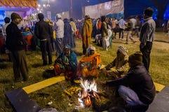 Hindu devotees , Babughat, Kolkata. BABUGHAT, KOLKATA, WEST BENGAL / INDIA - 9TH JANUARY 2013 : Hindu devotees lighting a camp fire on 9th January, 2013 in Royalty Free Stock Photos