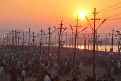 Hindu devotees come to confluence of the Ganges River for holy dip during the festival Kumbh Mela Stock Image