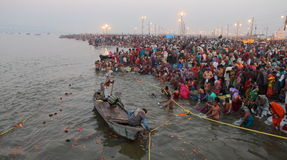Hindu devotees come to confluence of the Ganges River for holy dip during the festival Kumbh Mela Stock Images