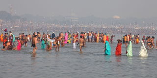Hindu devotees come to confluence of the Ganges River for holy dip during the festival Kumbh Mela Stock Photography