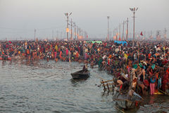 Hindu devotees at Kumh Mela festival. Allahabad, India - February 10, 2013: Thousands of Hindu devotees come to the confluence of the Ganges and the Yamuna River stock photos