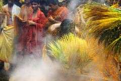Hindu devotees perform the turmeric bathing ritual during the annual festival held at Amman temple Royalty Free Stock Photography