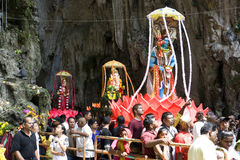 Hindu Devotees at Thaipusam Celebration. Hindu devotees and visitors at Malaysia's Thaipusam celebration. Also seen are 3 kavadis that are carried by devotees Stock Photo