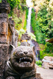 Hindu dragon statues detail with waterfall Gitgit Stock Photography