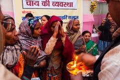 Hindu Female devotees , Babughat, Kolkata. BABUGHAT, KOLKATA, WEST BENGAL / INDIA - 9TH JANUARY 2013 : Hindu female devotees praying holy fire on 9th January Stock Images