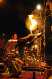 Hindu fire ritual. VARANASI, INDIA - APRIL 1: Unidentified priests perform fire ritual during religious Ganga Aarti on April 1, 2011 at Varanasi, Uttar Pradesh Royalty Free Stock Photos