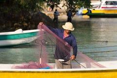 Hindu fisherman men preparing net for fishing Stock Photography