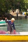 Hindu fisherman men preparing net for fishing Stock Image