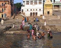 Hindu Ghats on the River Ganges - Varanasi - India. Crowds of devotees at the Hindu Ghats on the Holy River Ganges in Varanasi (Benares) in northern India Stock Photos