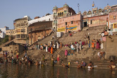 Hindu Ghats on the River Ganges - Varanasi - India. Crowds of devotees at the Hindu Ghats on the Holy River Ganges in Varanasi (Benares) in northern India Royalty Free Stock Image