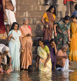 Hindu Ghats - Varanasi - India. Group of pilgrims on the Hindu ghats on the banks of the Holy River Ganges (Ganga) in Varanasi (Benares) in the Uttar Pradesh Stock Images
