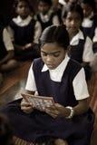 Hindu girls reading at school stock photo